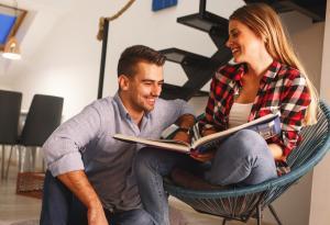 Couple, Reading, Sitting, Communicating