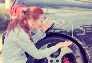 Vehicle Damage, Frustrated Woman, Parked Car