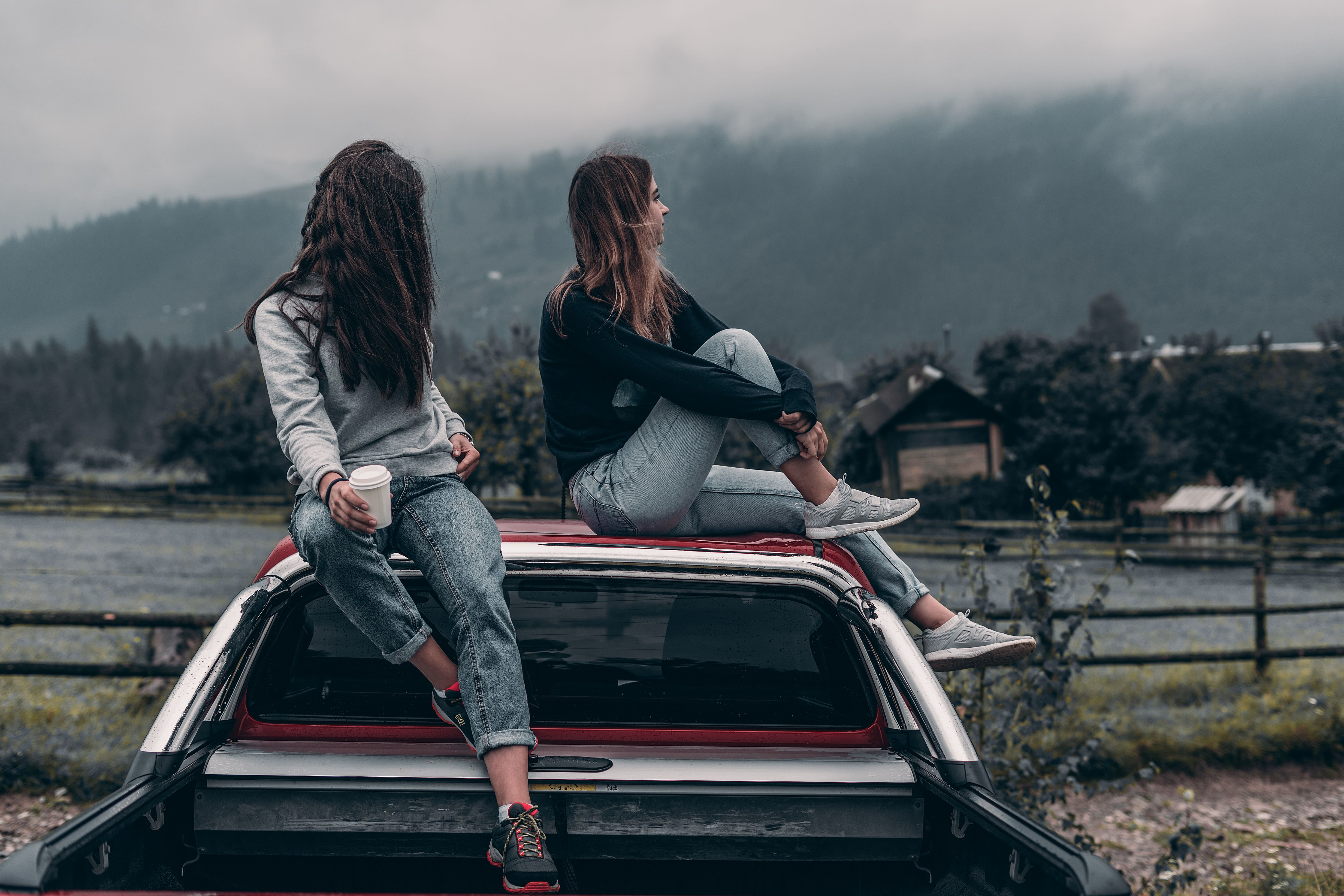 Two Women, Sitting, Outdoors, Car Roof